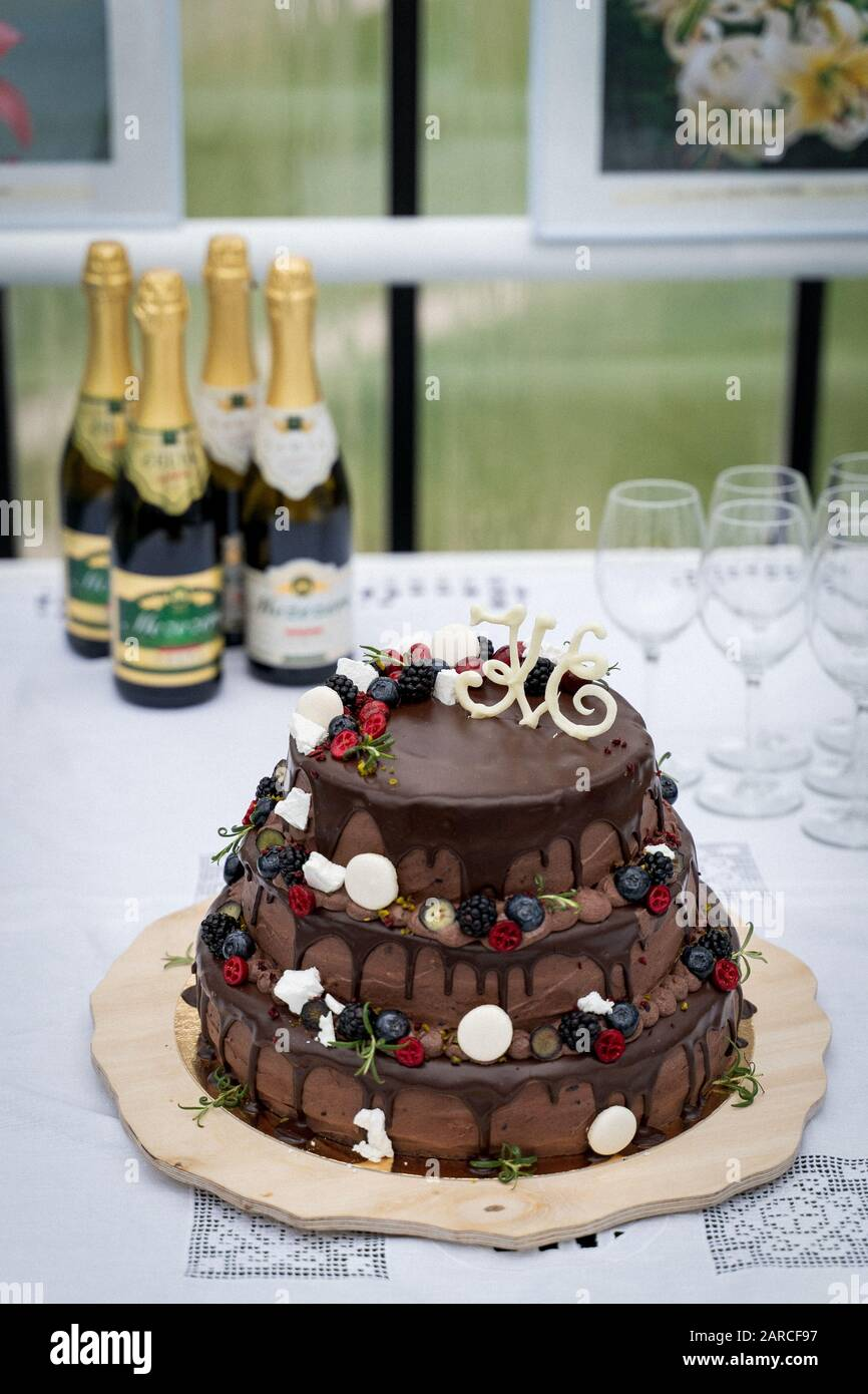 Magnificent A Vertical Shot Of A Big Chocolate Cake With Champagne Bottles And Personalised Birthday Cards Veneteletsinfo