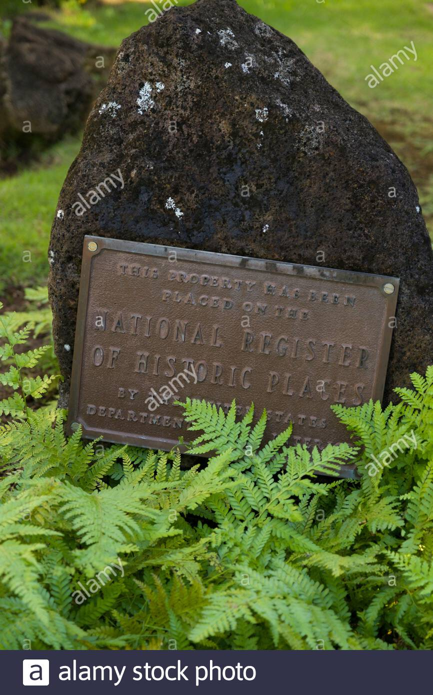 National Register of Historic Places metal placard on boulder outside the Queen Emma Summer Palace, Nuuanu, Honolulu, Oahu, Hawaii, USA Stock Photo