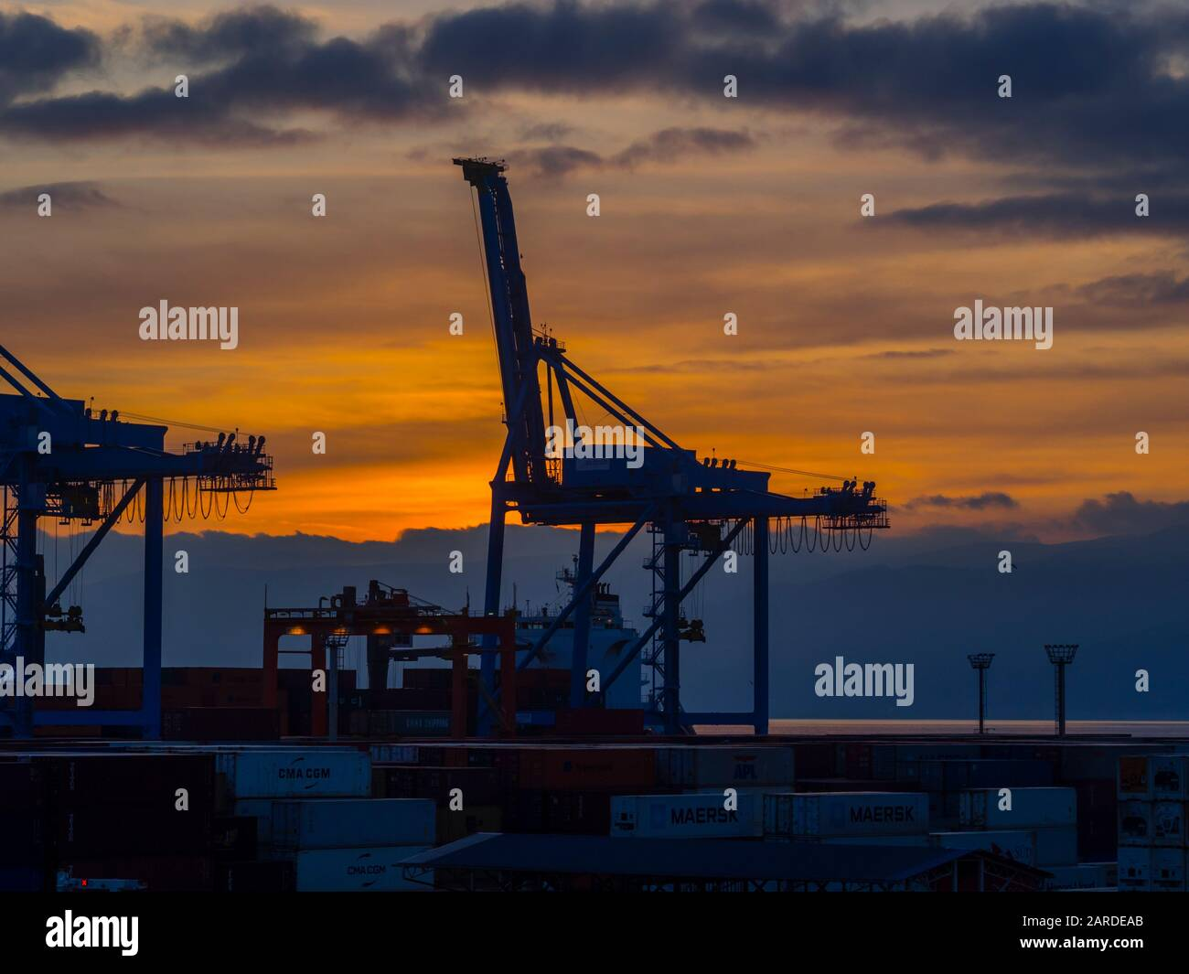 Dusk industrial skyline horizon silhouette in Brajdica harbor in Rijeka in Croatia Stock Photo