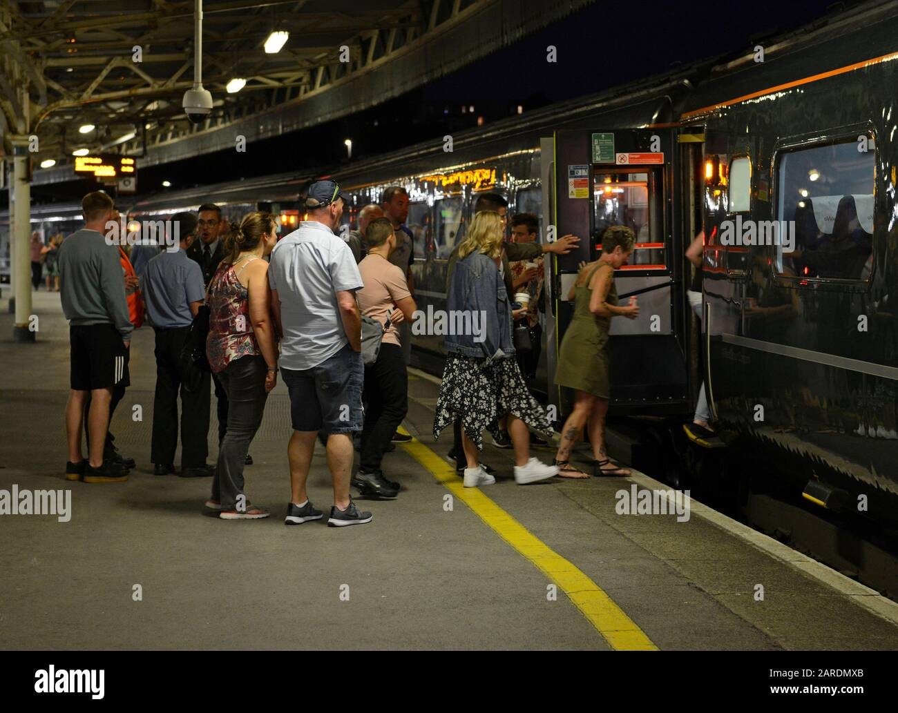 Passengers board a Great Western Railway company train at Bristol Temple Meads station. Stock Photo