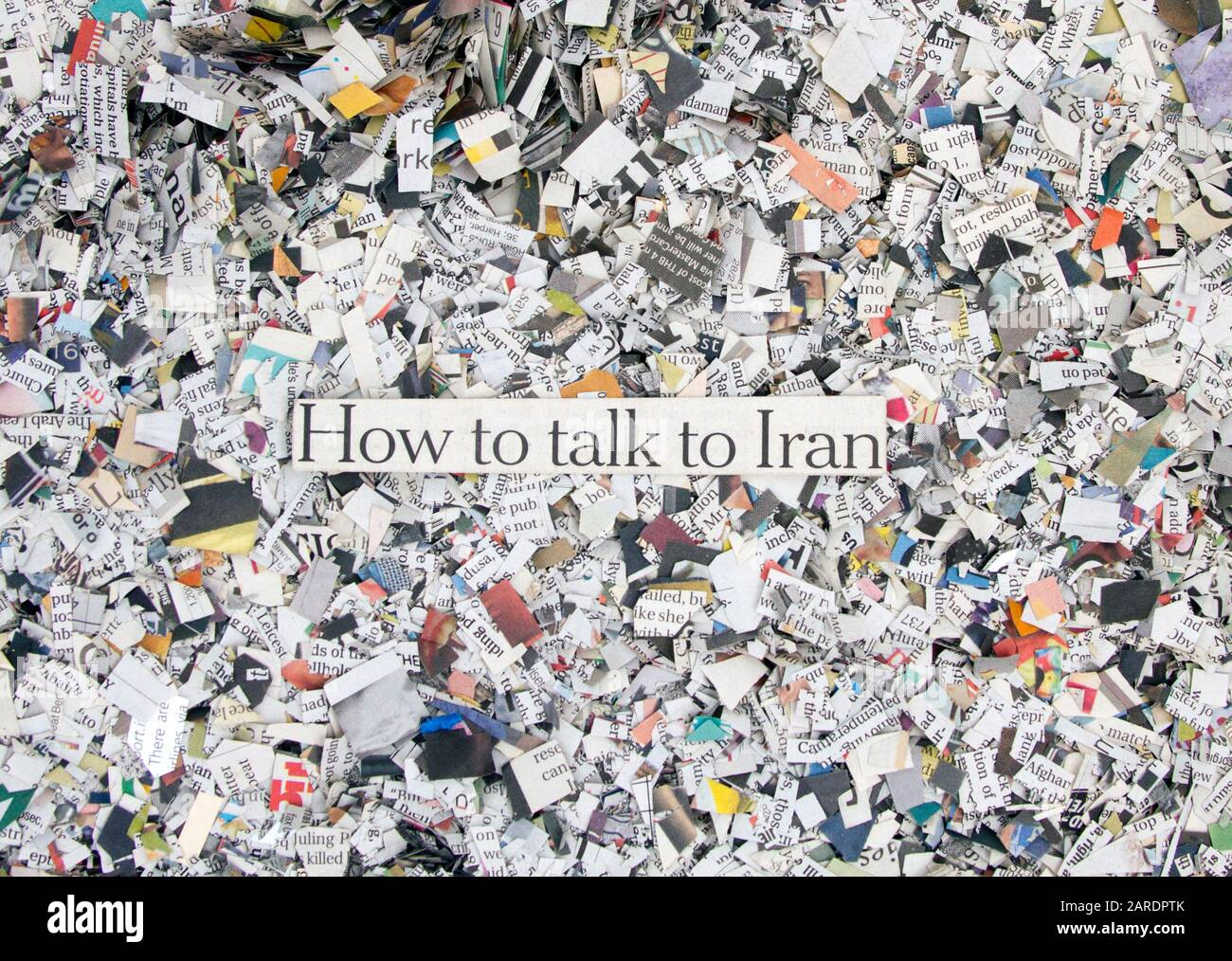 Newspaper confetti from above with the words How ti talk to Iran  Background Stock Photo