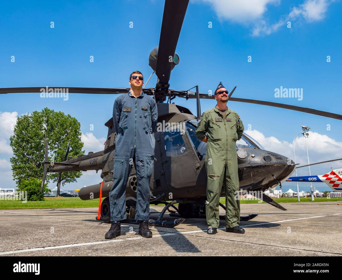 Kiowa Warrior OH-58D helicopter OH58D HRZ Croatian Air Force crew posing pose standing Stock Photo