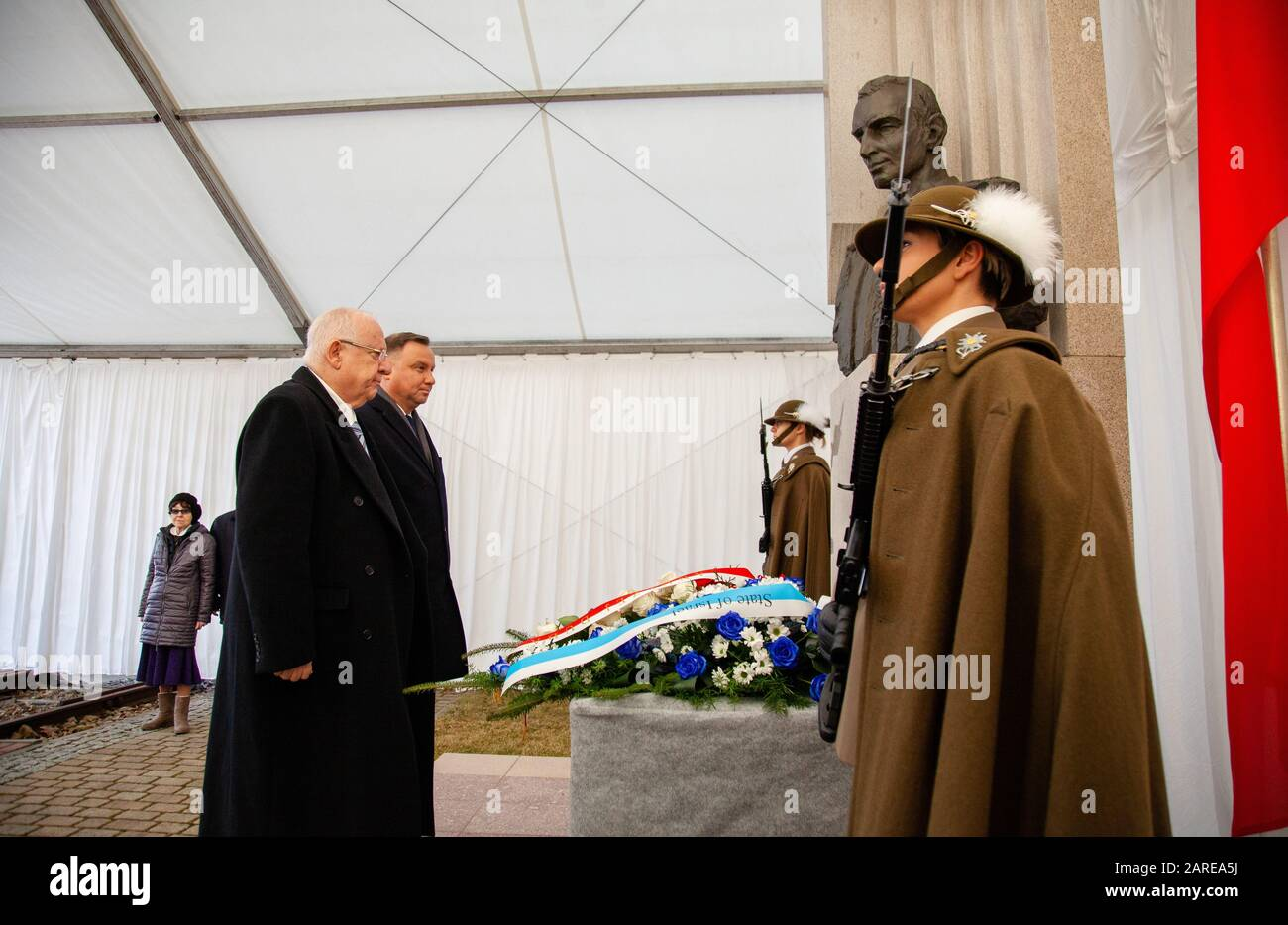 Oswiecim, Poland. 27th Jan, 2020. President of the Republic of Poland Andrzej Duda and the President of Israel Reuwen Riwlin lay flowers at the Monument of Captain Witold Pilecki during the 75th anniversary of the liberation of KL Auschwitz-Birkenau. Credit: SOPA Images Limited/Alamy Live News Stock Photo