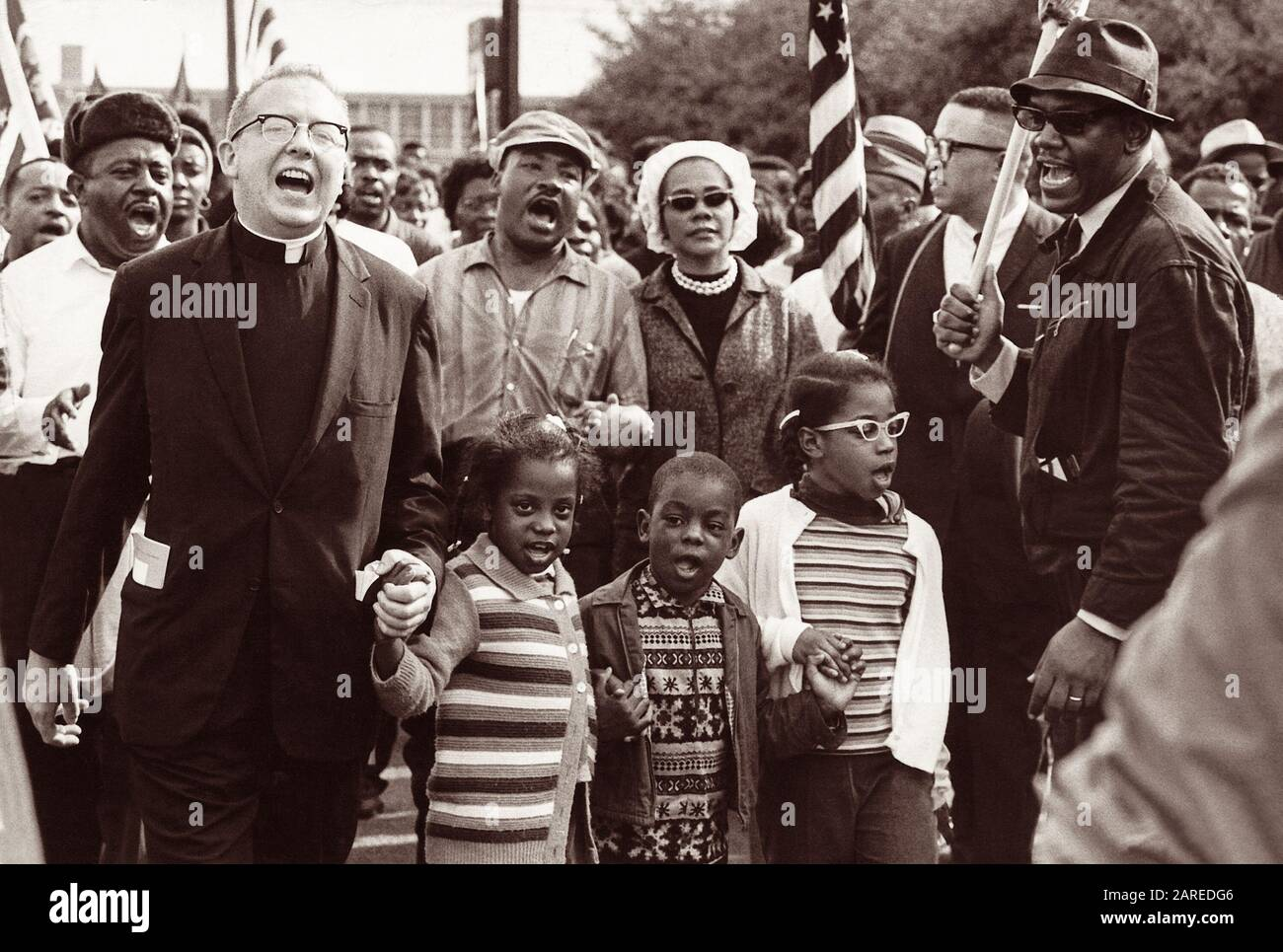 Front line of the Selma to Montgomery March with Dr. and Mrs. Martin Luther King (center), Dr. and Mrs. Ralph David Abernathy (with their children Donzaleigh, Ralph David, and Juandalynn), and John Lewis in March, 1965. (Name of white minister is unknown.) Stock Photo