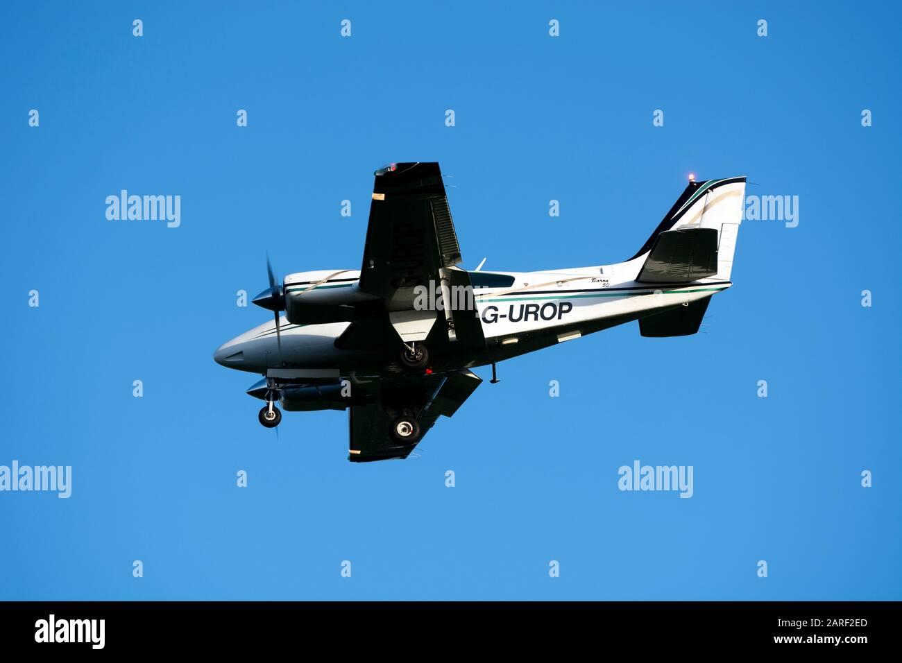 Beech 95-B55 Baron landing at Wellesbourne Airfield, Warwickshire, UK (G-UROP) Stock Photo