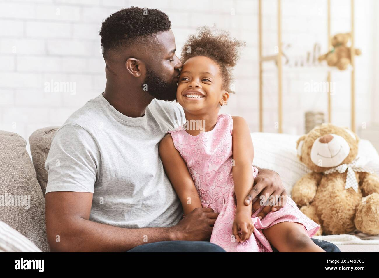 Loving Black Dad Kissing His Happy Little Daughter Stock Photo Alamy