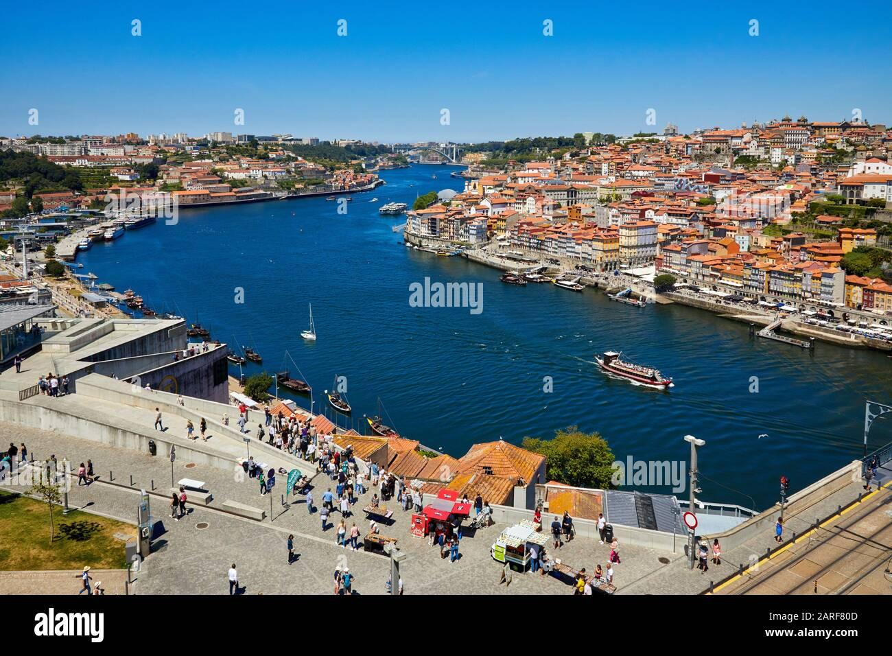 Tourist boat, Rio Douro river, Ponte Dom Luis I bridge, Porto, Portugal Stock Photo