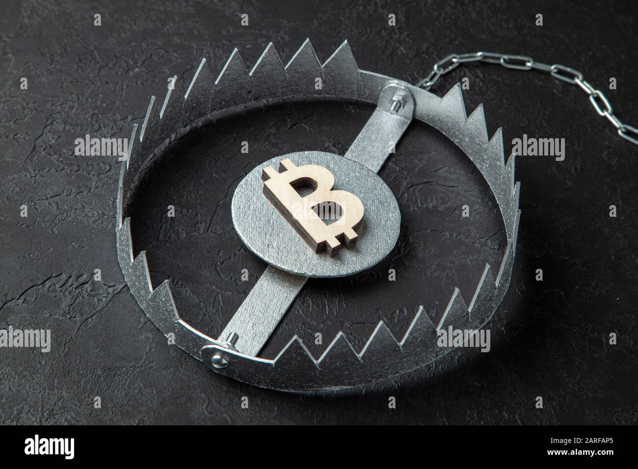 Bitcoin sign in a trap. Cryptocurrency is a trap for money. Stock Photo