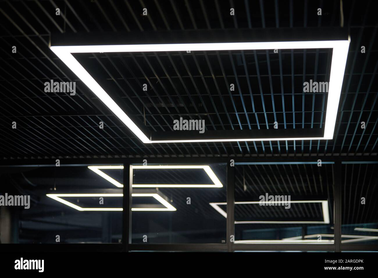 Modern Office Lighting Thin Lamps In Office Dark Ceiling Led White Cold Light Over Workplaces Stock Photo Alamy