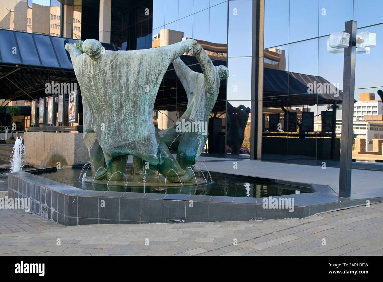 Statues in front of Joburg Theatre called The Playmakers by Ernest Ullman, Braamfontein, Johannesburg, Gauteng, South Africa. Stock Photo