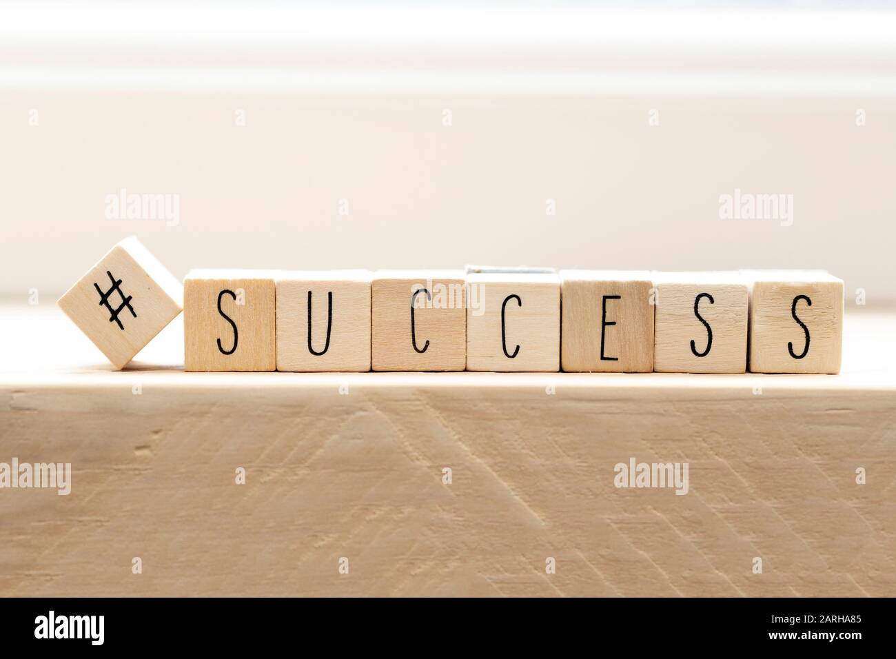 Hashtag with succes written wooden cubes, social media concept Stock Photo