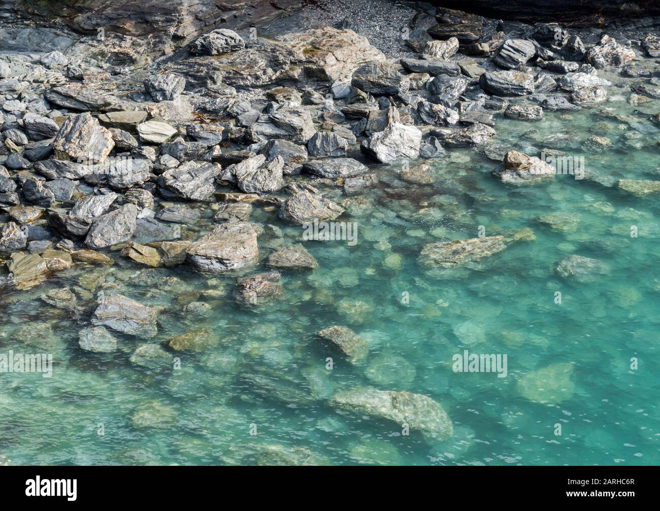 Crystal Clear Turquoise Waters Over Rocks On The Beach Cornwall