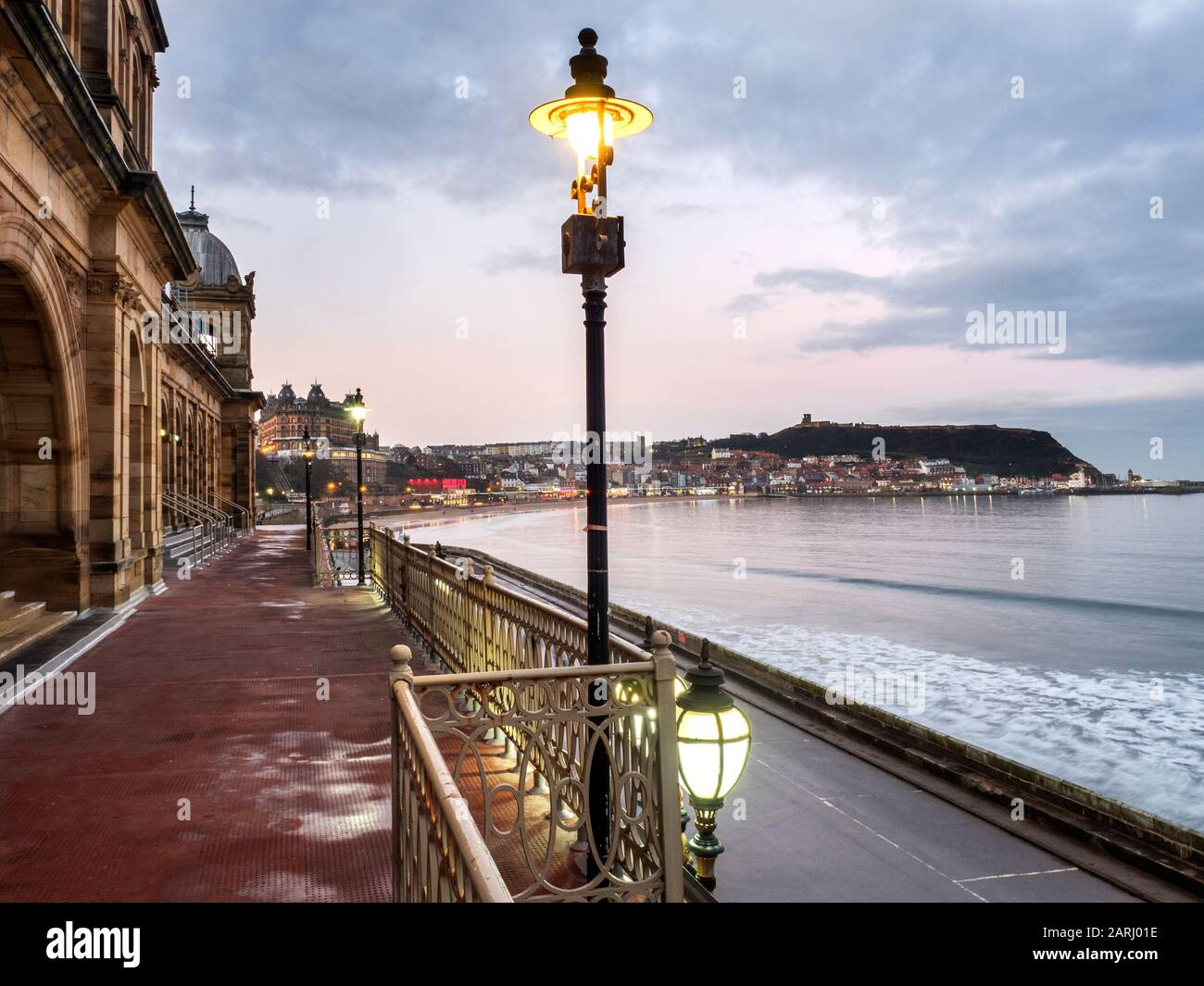 View from Scarborough Spa at dusk across South Bay towards Castle Hill Scarborough North Yorkshire England Stock Photo