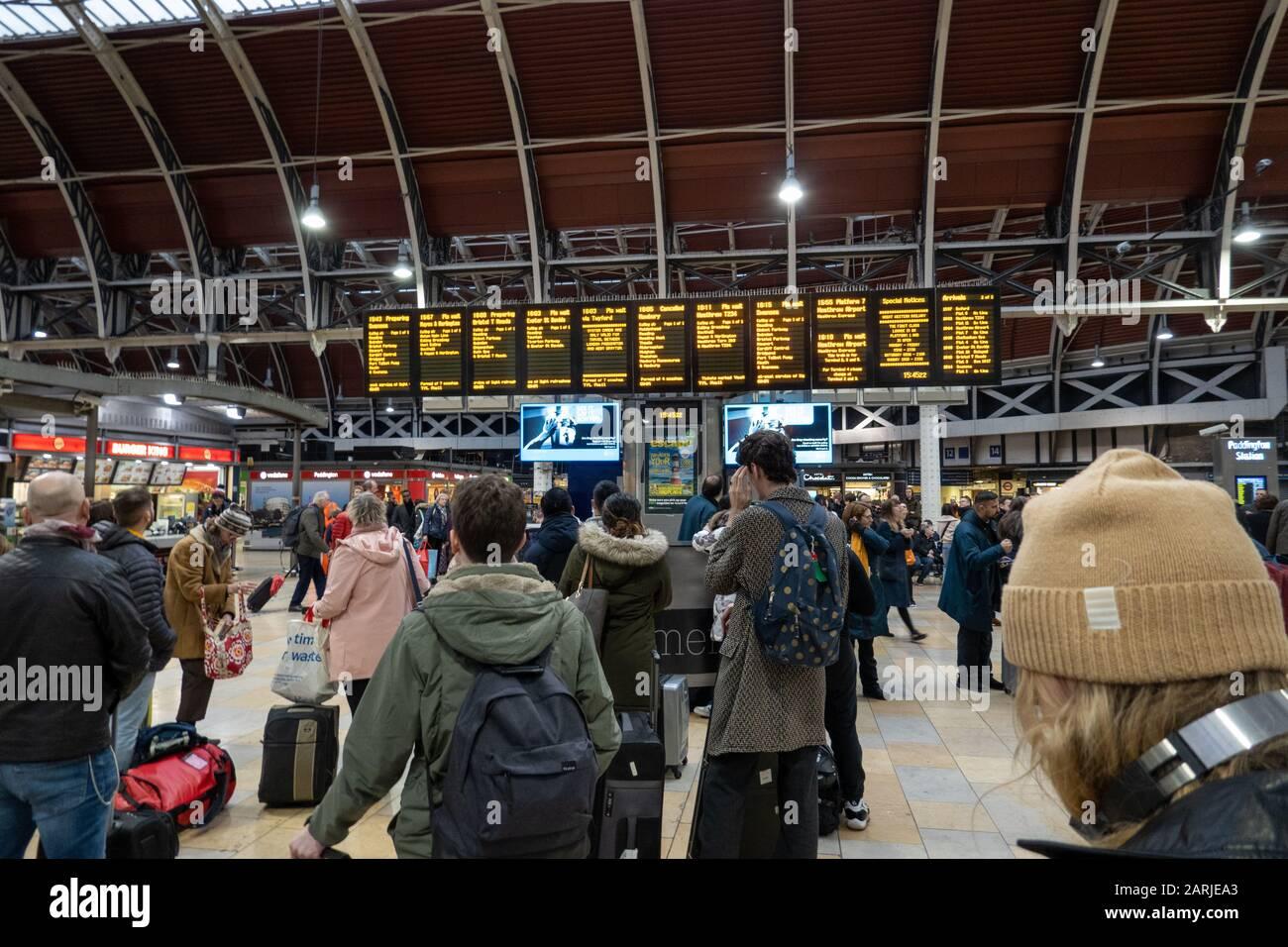 Passengers waiting at Train Departure board, Paddington Station, London, UK Stock Photo