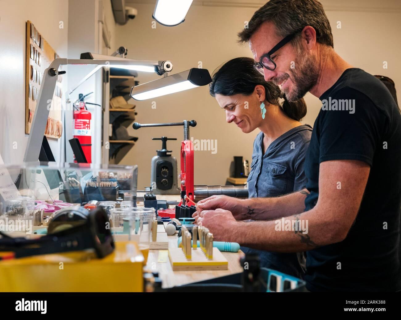 Customers learn to craft jewelry; Riveting Experience Jewelry; Salida; Colorado; USA Stock Photo