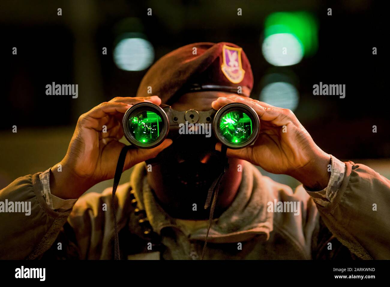 U.S. AIR FORCE ACADEMY, Colo. – Airman First Class Richard Scott, a Security Forces Installation Entry Controller, uses night vision binoculars during a night shift on Jan. 7, 2020 at the U.S. Air Force Academy's North Gate. (U.S. Air Force photo/Trevor Cokley) Stock Photo