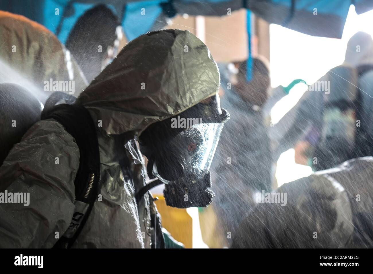 U.S. Marine Corps Lance Cpl. Kimberly Ortiz Marrero, a native of Lancaster, N.Y. and the hazardous material and safety representative for 3rd Transportation Support Battalion, stands while being decontaminated during the Hazardous Waste Operations and Emergency Response course at Camp Foster, Okinawa, Japan, Sept. 19, 2019. After completing an exercise, all the students who wore hazardous material suits had to undergo a mock-decontamination procedure where they entered a tent and were sprayed with water. (U.S. Marine Corps photo by Lance Cpl. Ryan H. Pulliam) Stock Photo
