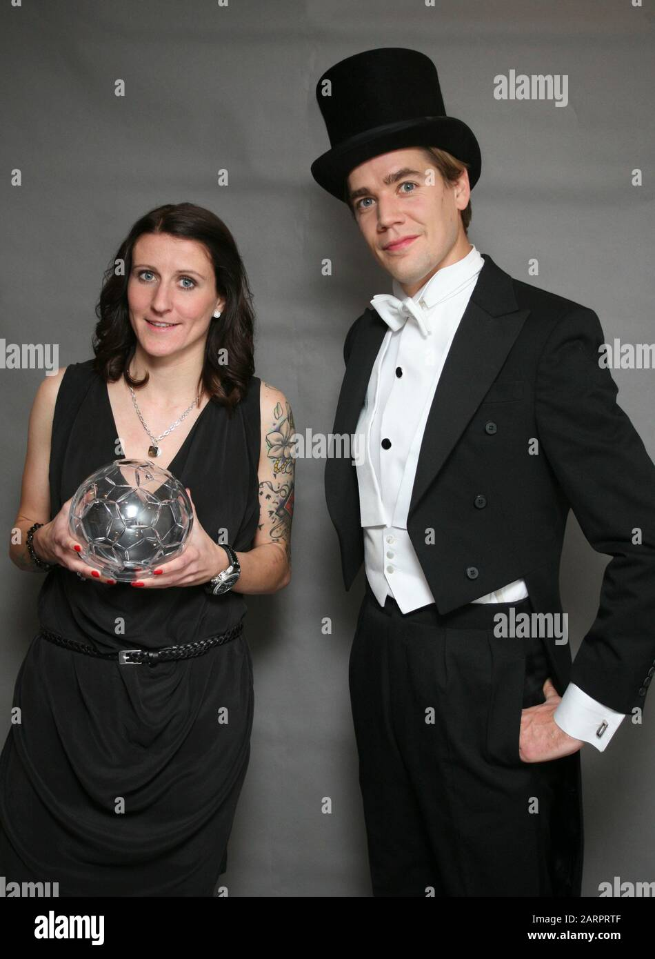 PELLE ALMQVIST singer in Swedish group The Hives  award German player in Swedish football league Anja Mittag as striker of the year Stock Photo