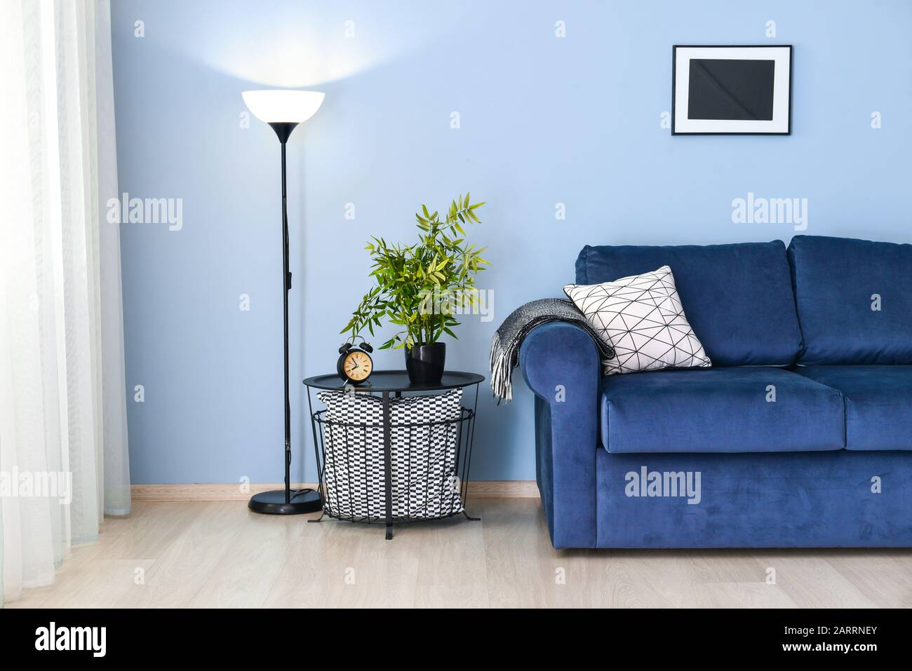 Interior Of Modern Room With Blue Sofa And Table Near Color Wall Stock Photo Alamy