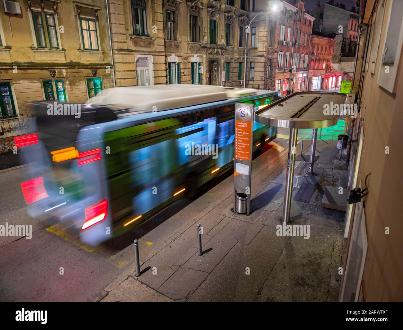 Blue bus in movement on station in Rijeka Croatia by night Stock Photo
