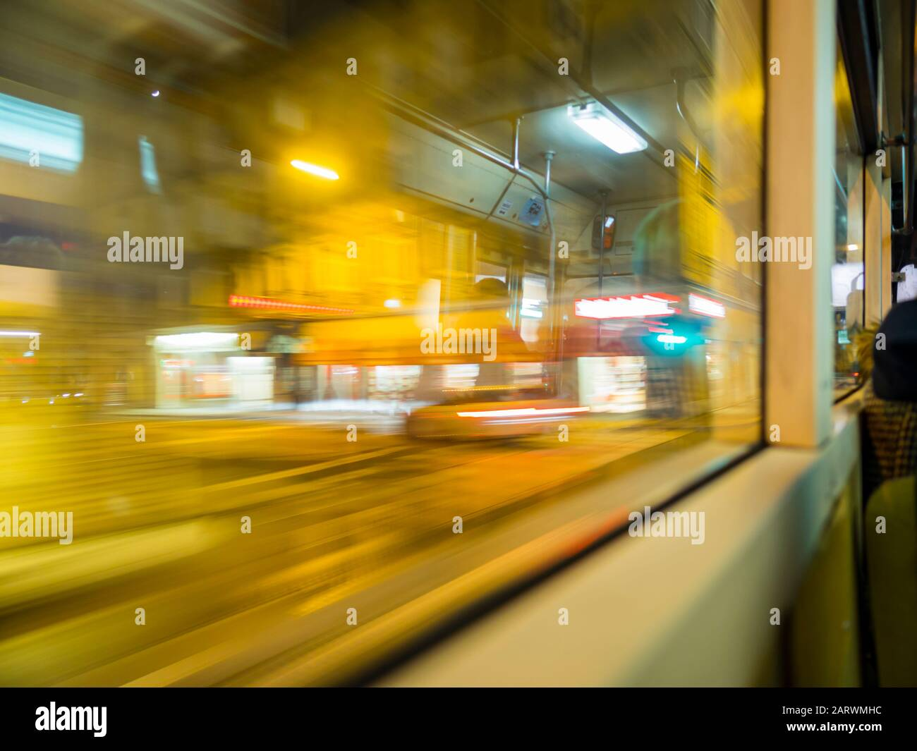 View from bus through window city town urban street motion moving driving intentionally blurry blur background Rijeka Croatia Stock Photo