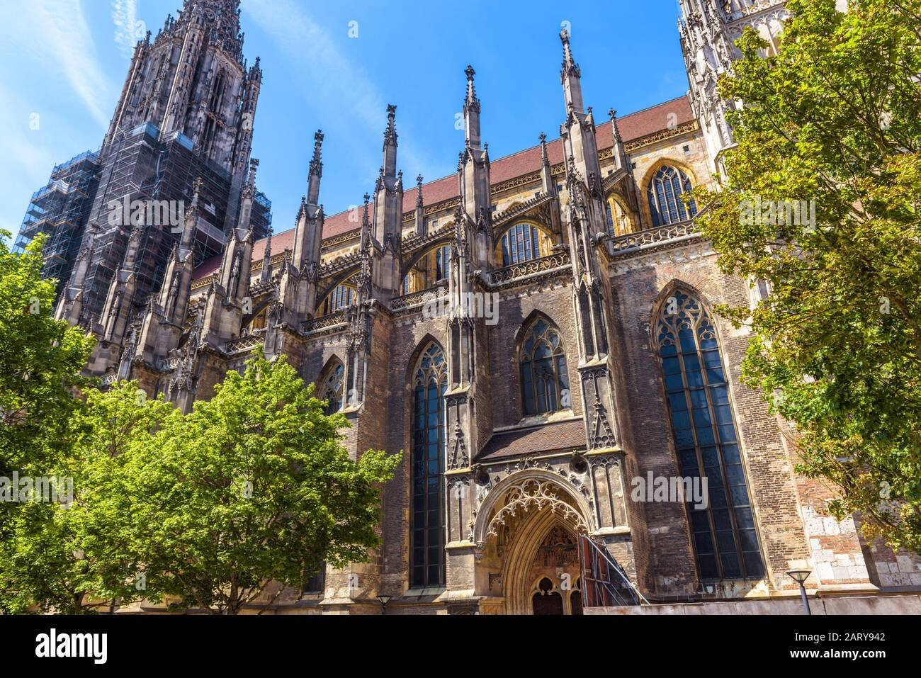 Ulm Minster or Cathedral of Ulm city, Germany. It is a famous landmark of Ulm. Ornate facade of Gothic church in summer. Scenery of medieval European Stock Photo