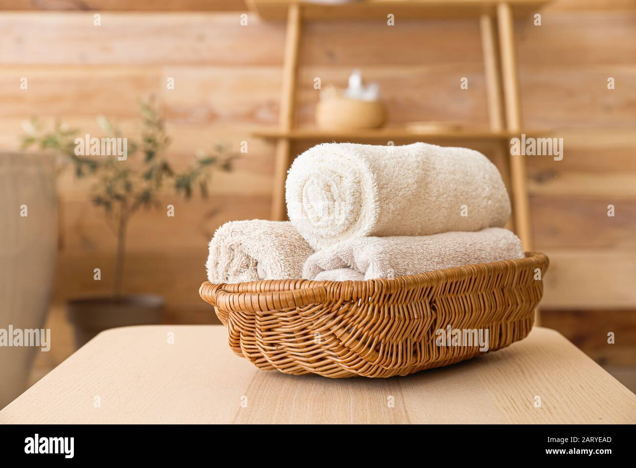 Basket With Clean Towels On Table In Bathroom Stock Photo Alamy