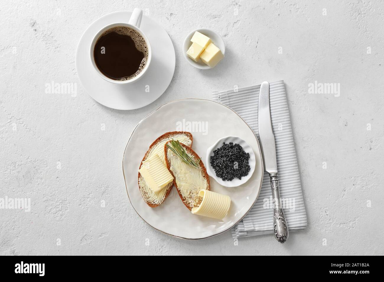 Tasty Breakfast With Fresh Bread Butter Black Caviar And Cup Of Coffee On White Background Stock Photo Alamy