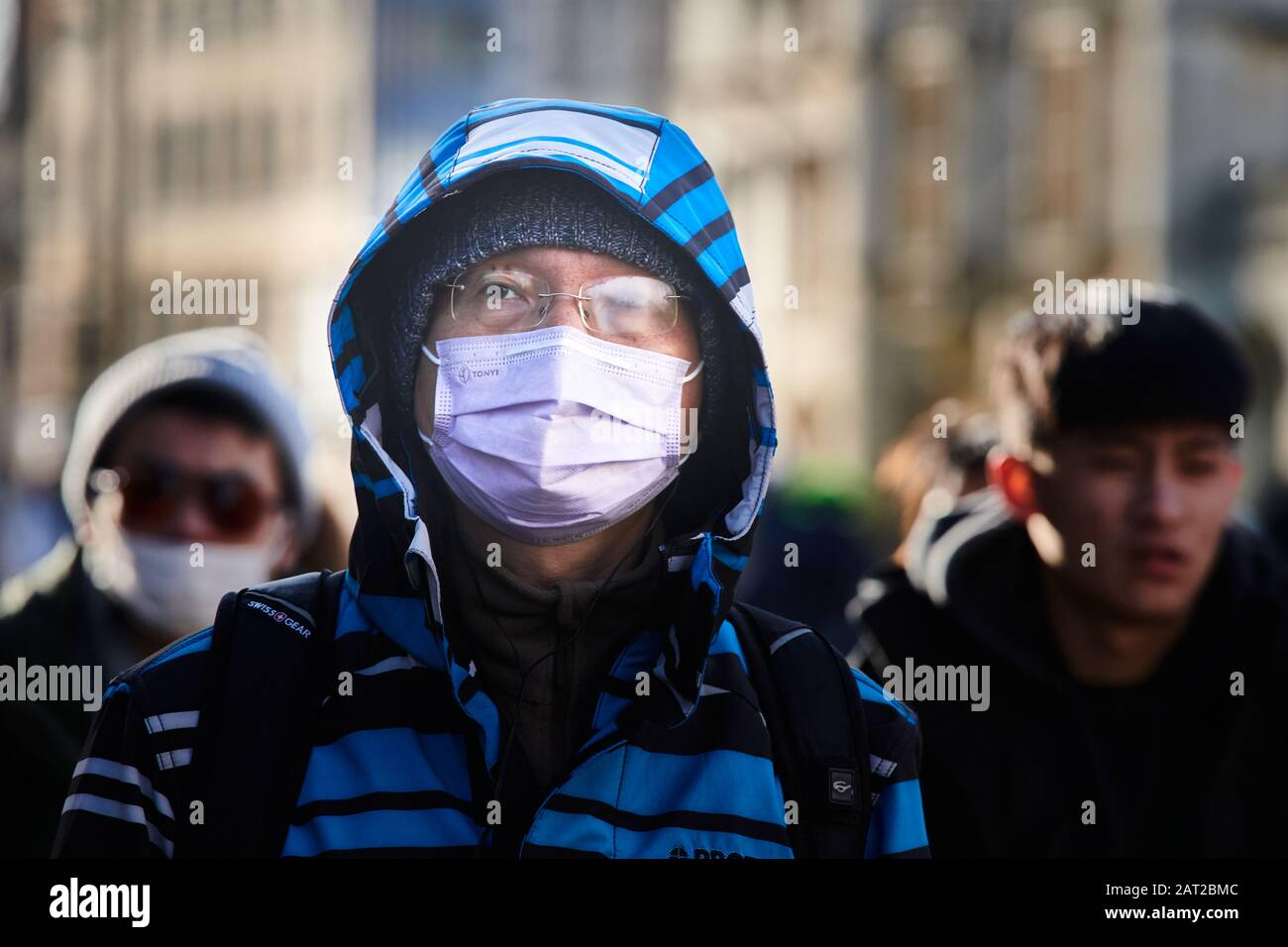 Face mask worn by a chinese tourist outside King's college, Cambridge, England, on 30 january 2020, to prevent catching the coronavirus flu. Stock Photo