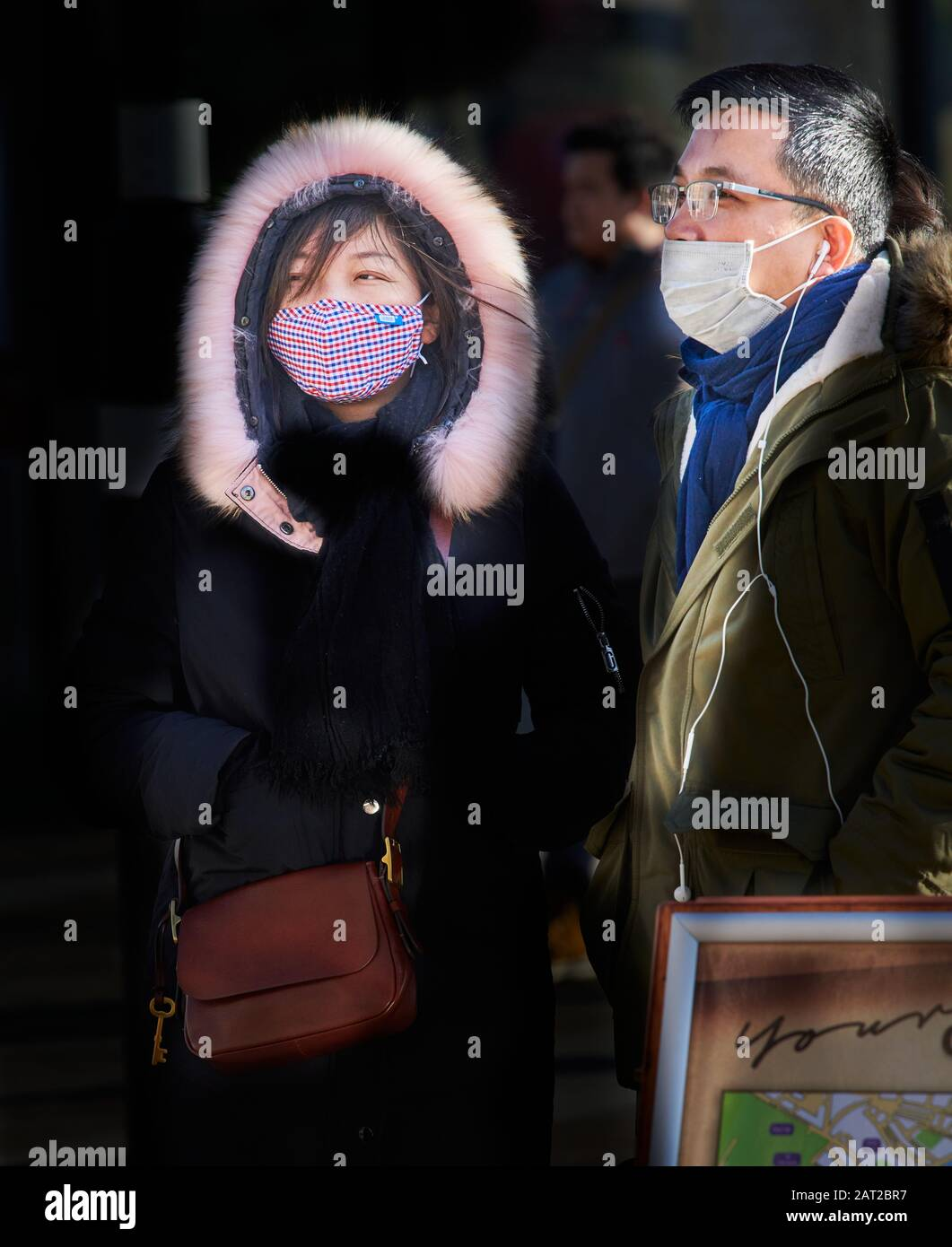 Face mask worn by chinese tourists outside the railway station in Cambridge, England, on 30 january 2020, to prevent catching the coronavirus flu. Stock Photo