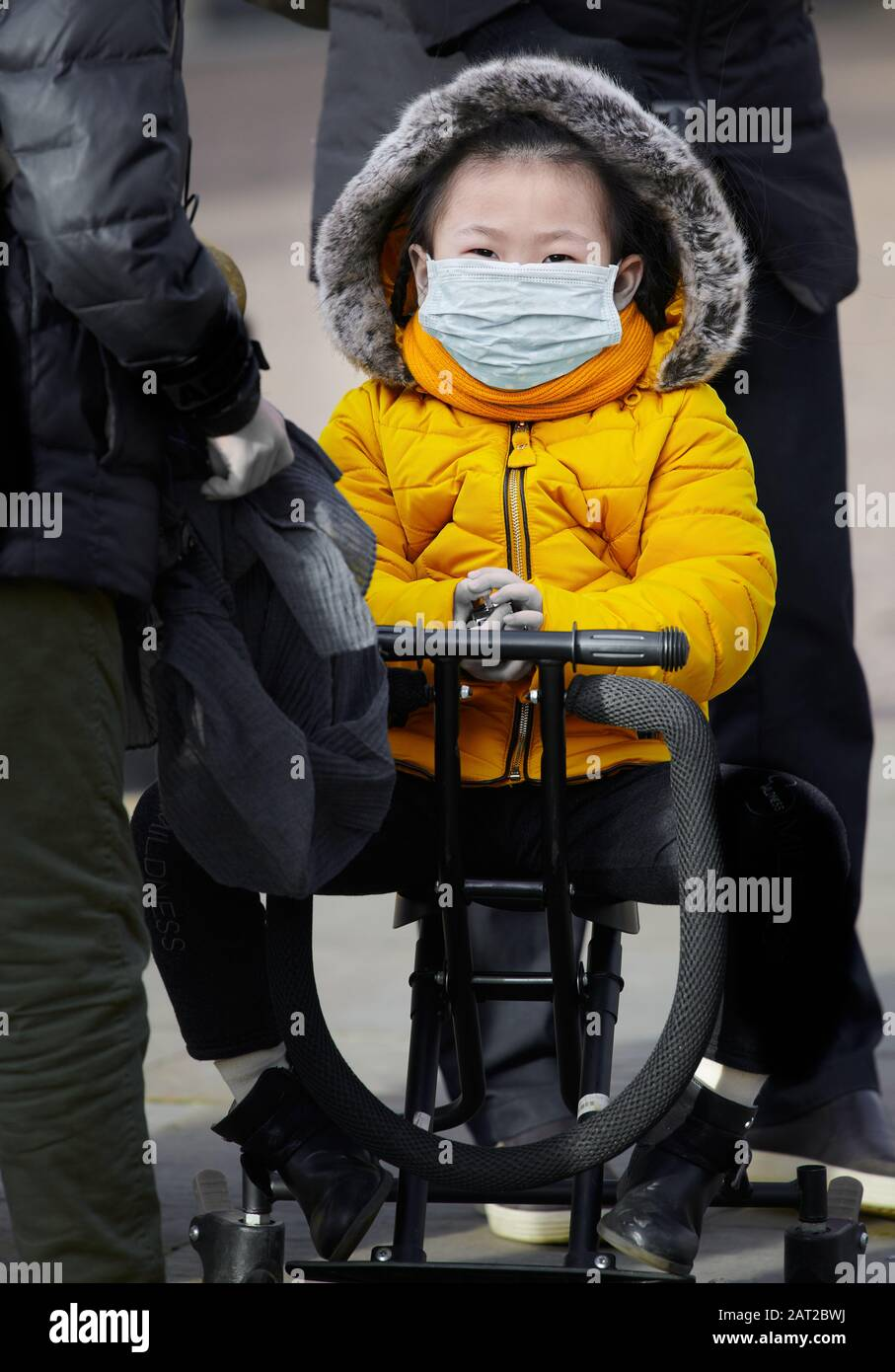 Face mask worn by a young chinese girl in Cambridge, England, on 30 january 2020, to prevent catching the coronavirus flu. Stock Photo