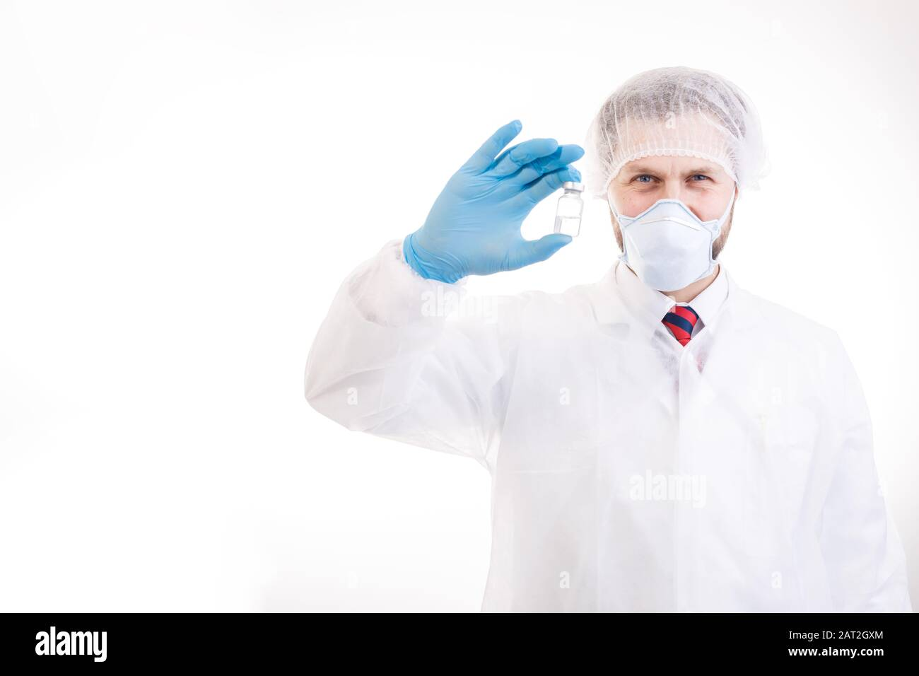 Cheerful Doctor Demonstrating an Antivirus Vaccine Bottle Stock Photo