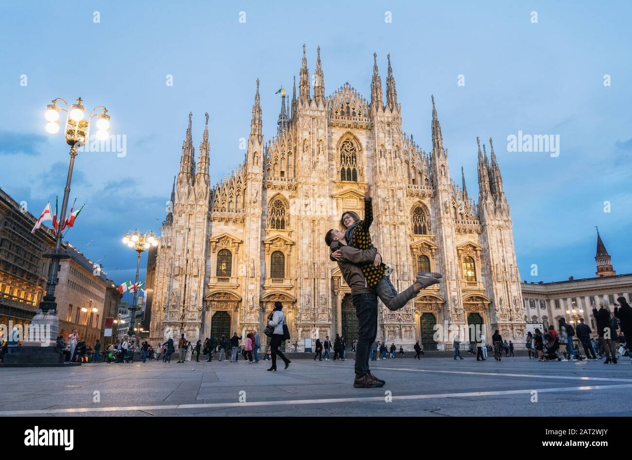 Romantic young couple embracing in front of the Duomo, Milan, Italy Stock Photo