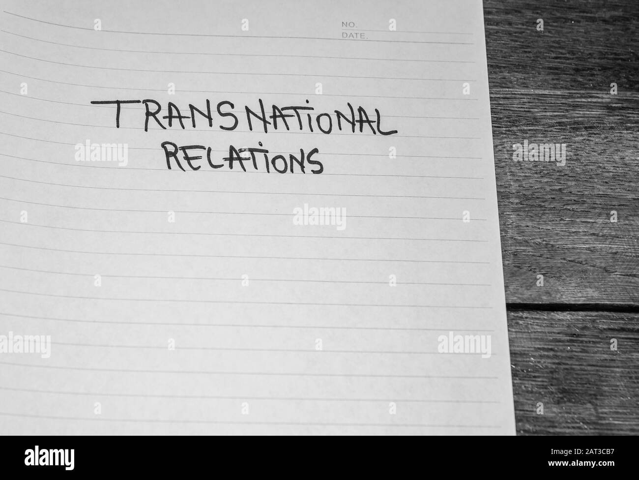 Transnational relations, handwriting  text on paper, political message. Political text on office agenda. Concept of democracy, voting, politics. Copy Stock Photo