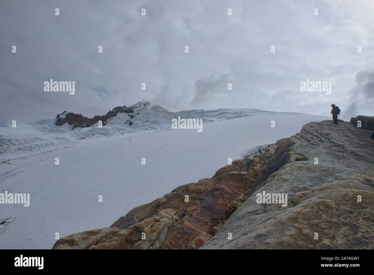 Climber overlooking the Ritacuba Glacier, El Cocuy National Park, Boyaca, Colombia Stock Photo
