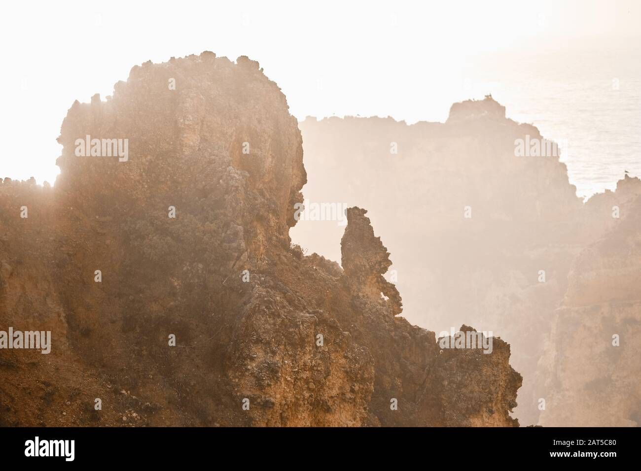 Ponta da Piedade headland with group of rock formations textures background yellow-golden cliffs along limestone coastline, Lagos town, Portugal Stock Photo
