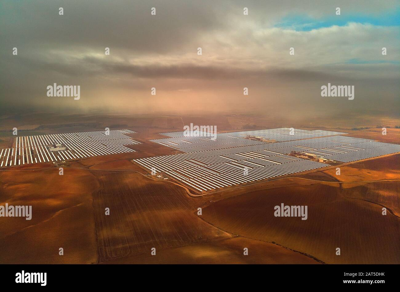 Aerial image drone point of view photo Gemasolar Concentrated solar power plant CSP, system generate solar power. Sevilla, Spain Stock Photo