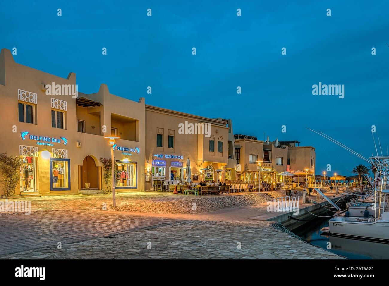 illuminated shopfronts lying on the promade along the Abu Tig marina in el Gouna, Egypt, January 14, 2020 Stock Photo
