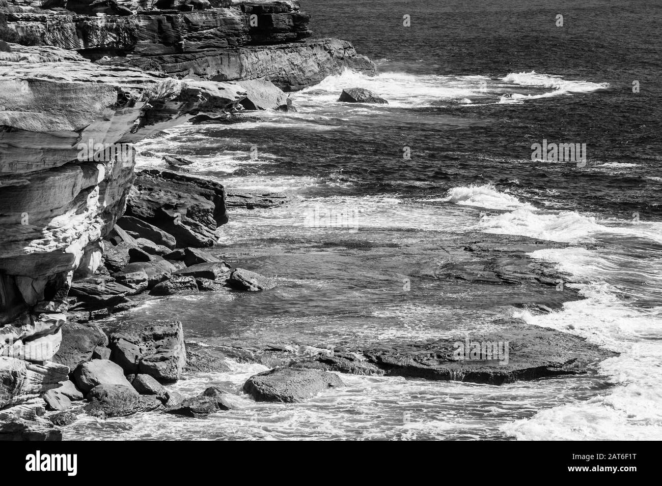 BW close up of the coastline from the Coogee to Bondi walk Stock Photo