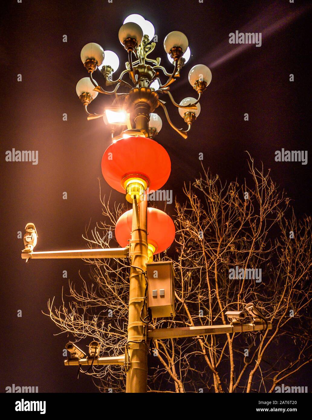 CCTV cameras on lantern pole in the capitol city of china Bejing. Concept of security, surveillance, being watched. Stock Photo