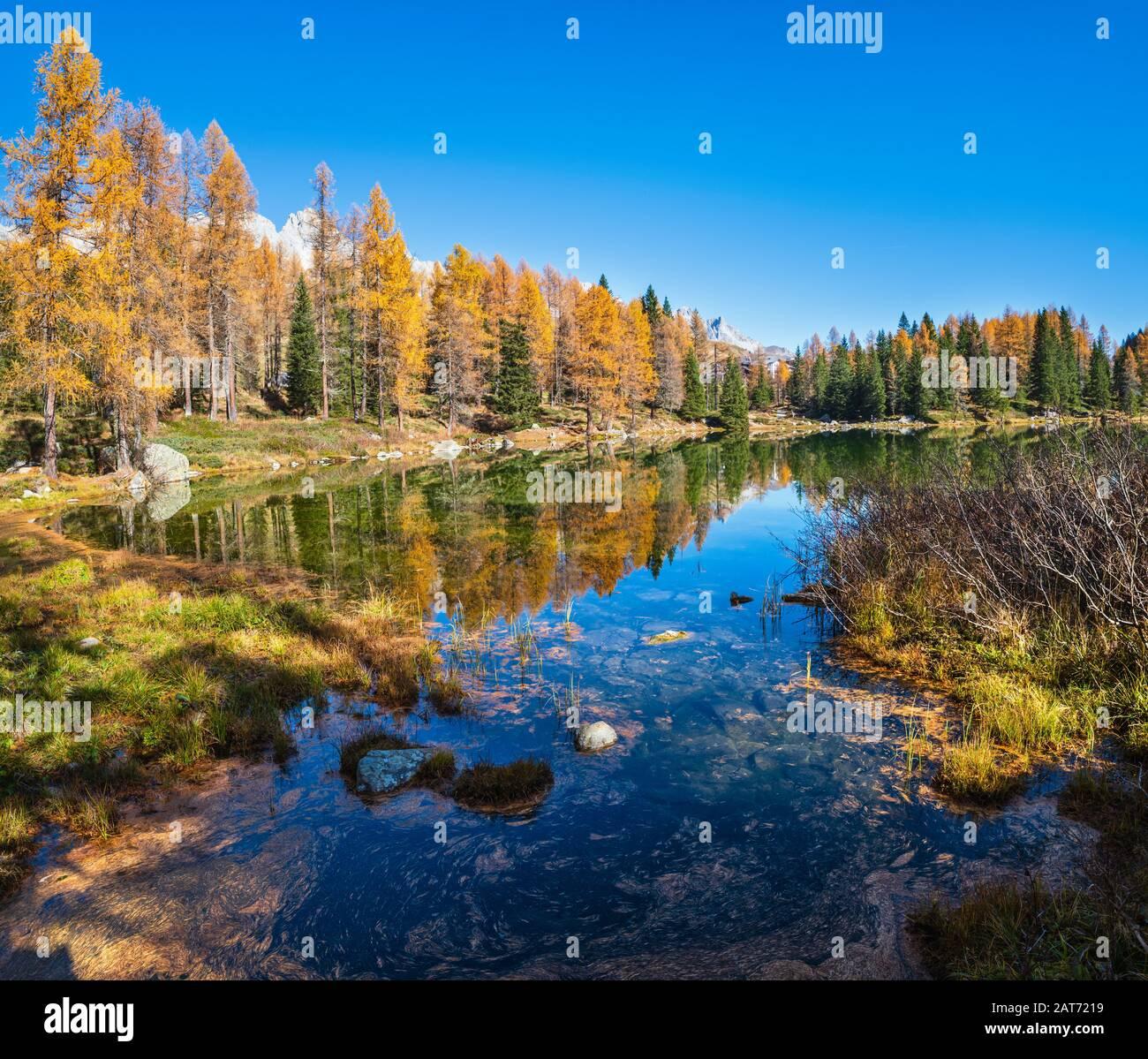 Autumn alpine mountain lake near San Pellegrino Pass, Trentino, Dolomites Alps, Italy. Picturesque traveling, seasonal and nature beauty concept scene Stock Photo