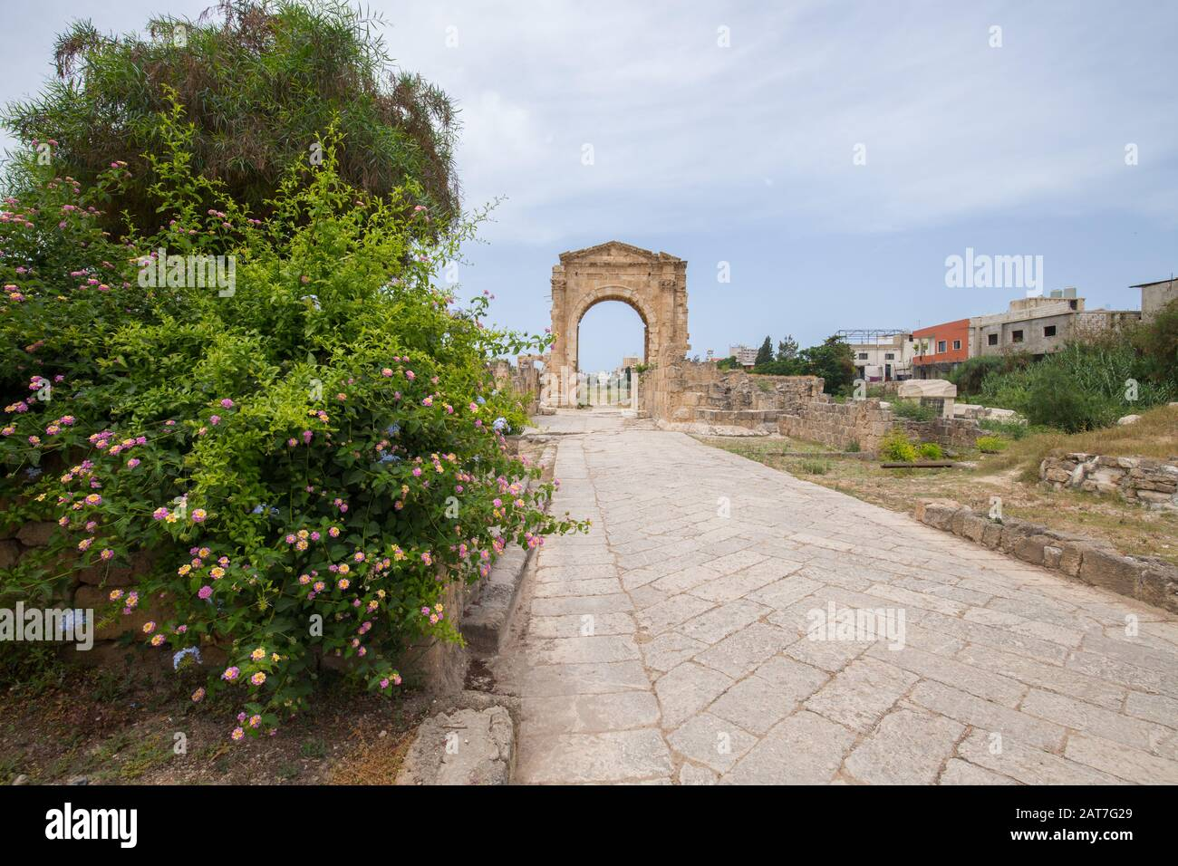 The arch of triumph and the Byzantine road. Roman remains in Tyre. Tyre is an ancient Phoenician city. Tyre, Lebanon - June, 2019 Stock Photo