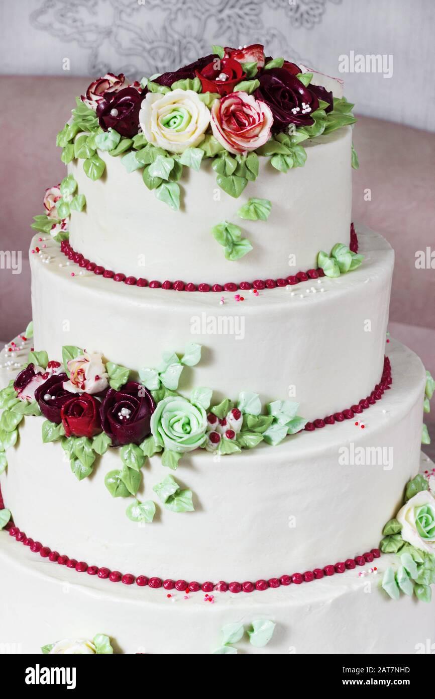 Festive Four Level White Elegant Cake With Cream Flowers Wedding Cake Cream Flowers In The Malaysian Technique Stock Photo Alamy