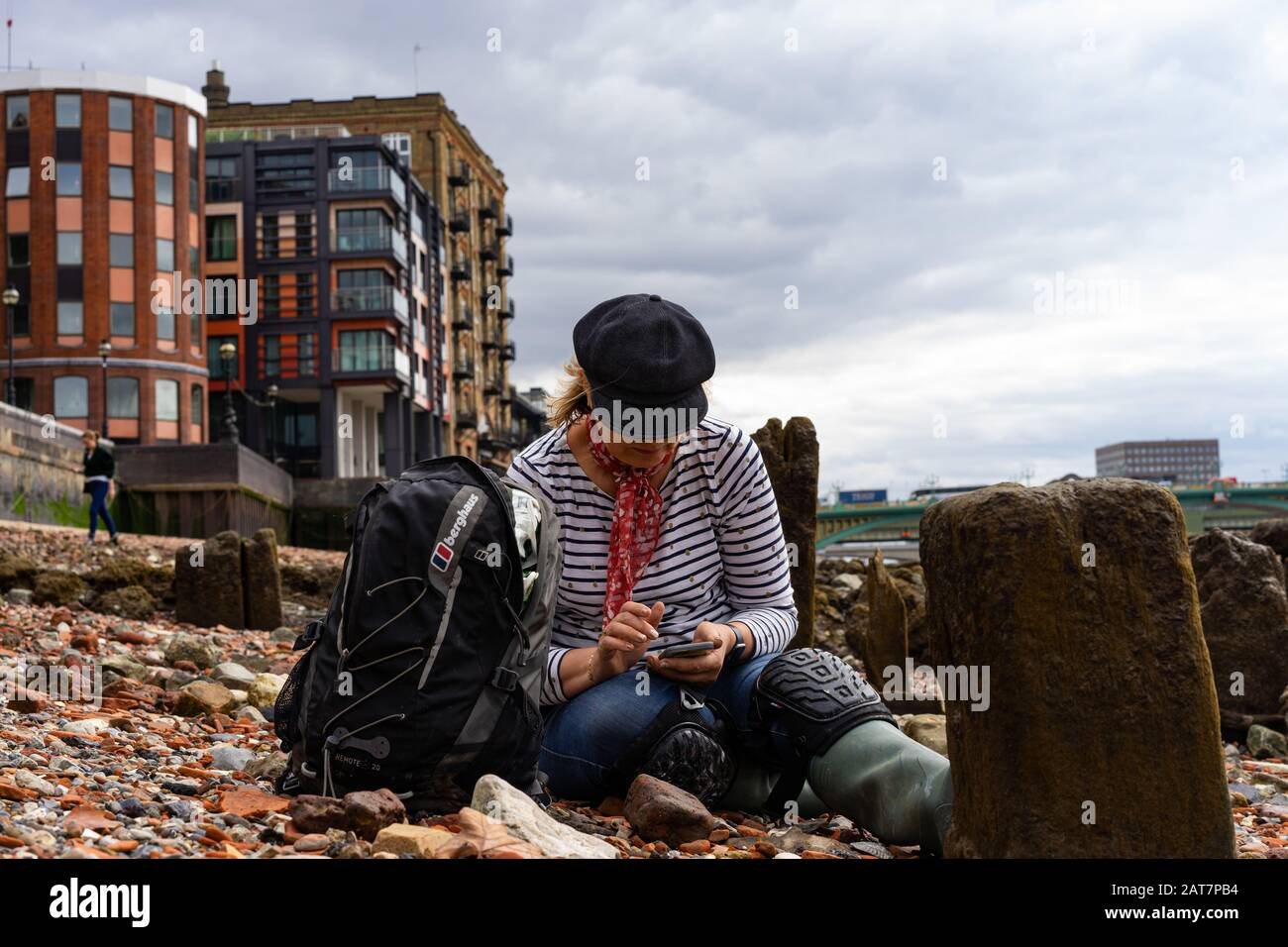 Mud-larker on the river Thames foreshore at low tide, London. Stock Photo