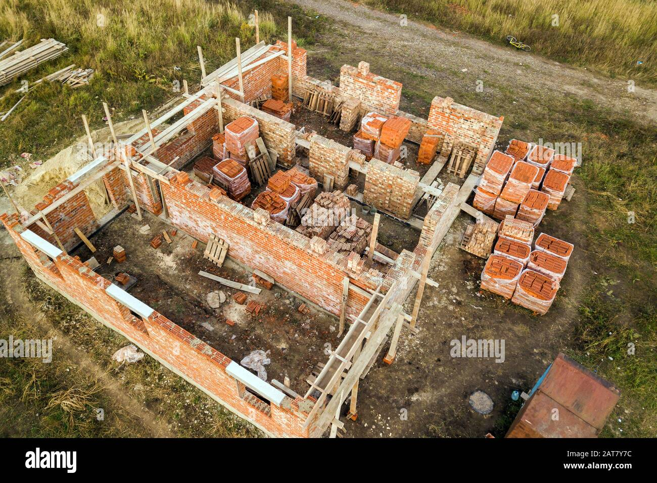 Aerial View Of Building Site For Future Brick House Concrete Foundation Floor And Stacks Of Yellow Clay Bricks For Construction Stock Photo Alamy