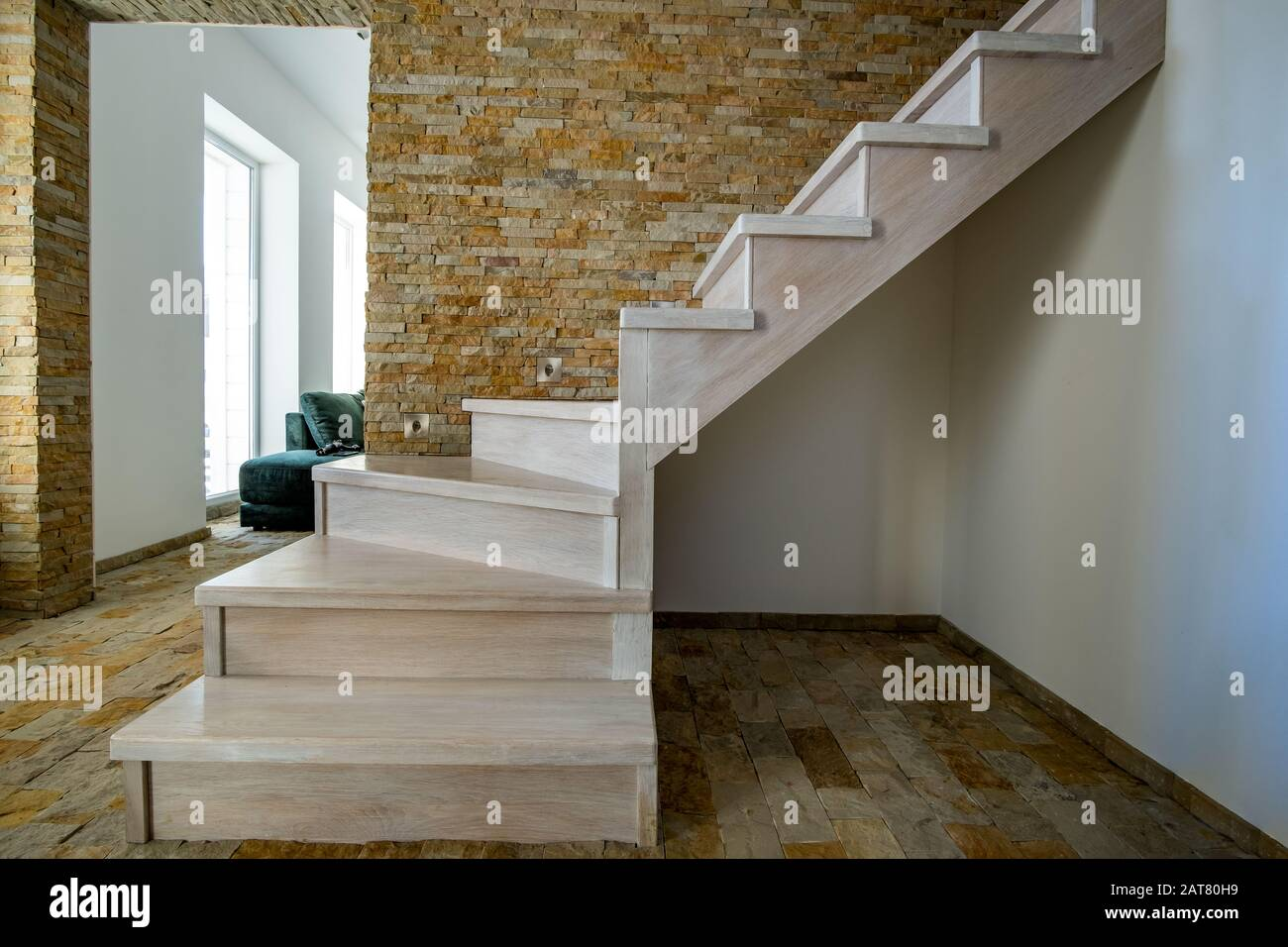 Stylish Wooden Contemporary Staircase Inside Loft House Interior Modern Hallway With Decorative Limestone Brick Walls And White Oak Stairs Stock Photo Alamy