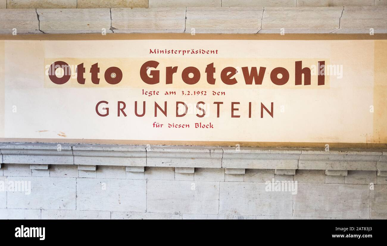 sign commemorating cornerstone ceremony by otto grotewohl at housing complex at karl-marx-allee Stock Photo
