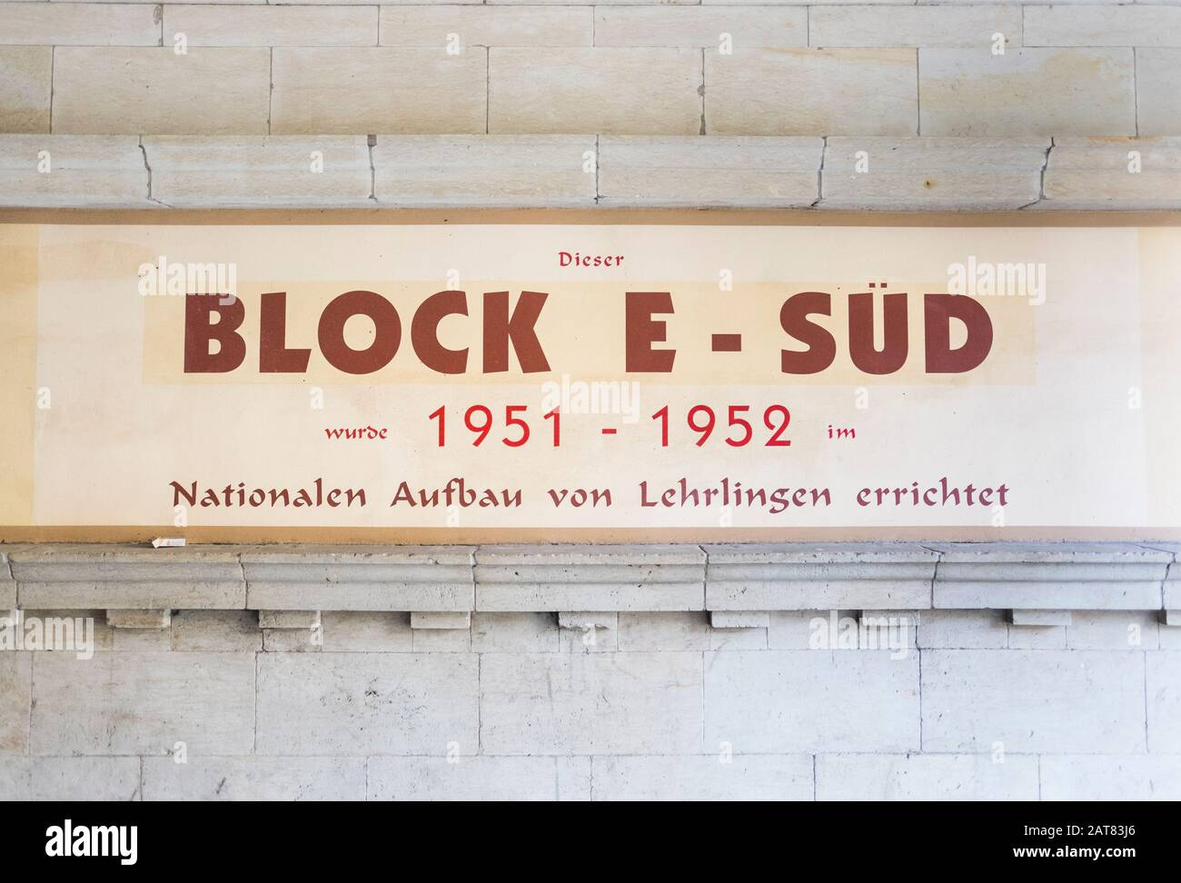 signboard commemorating the contribution of apprentices during the construction of residential buildings at housing complex at karl-marx-allee Stock Photo