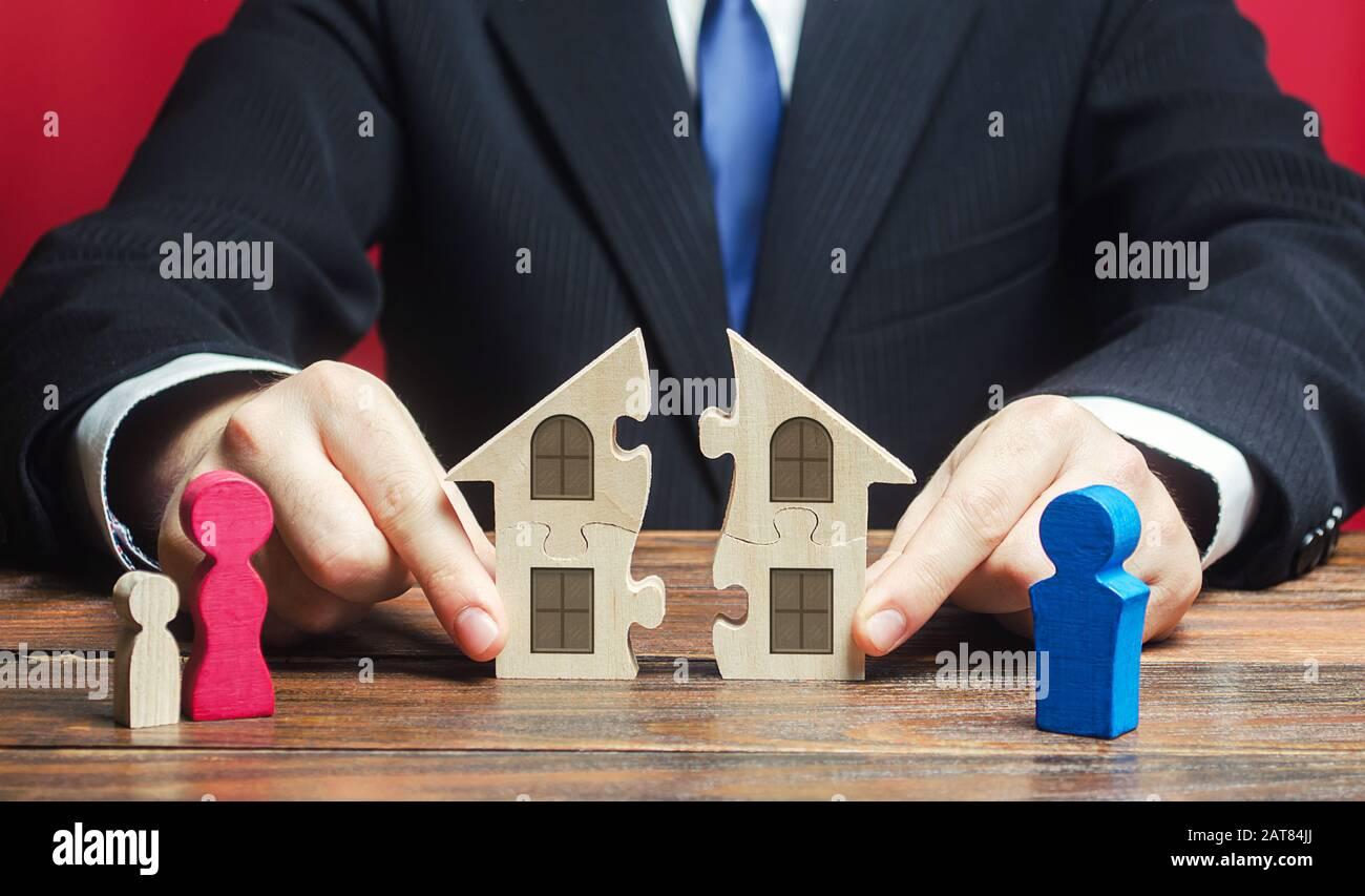 Lawyer controls separation and connection of house between husband and wife. Marriage contract. Former spouses in divorce process. Conflict resolution Stock Photo