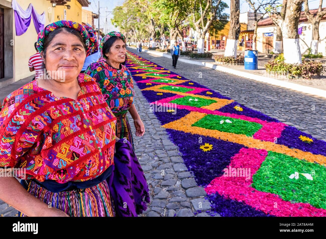 Antigua, Guatemala -  April 14, 2019: Maya ladies & Palm Sunday procession carpet in UNESCO World Heritage Site with famed Holy Week celebrations. Stock Photo